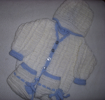 Hand crocheted baby clothes by Grace